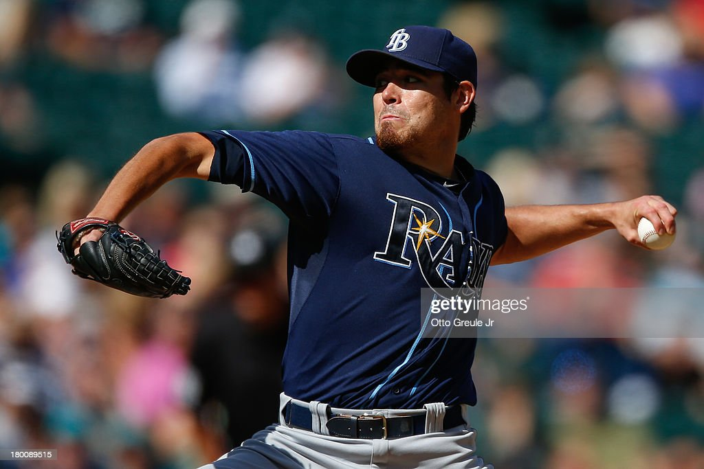 Starting pitcher <a gi-track='captionPersonalityLinkClicked' href=/galleries/search?phrase=Matt+Moore+-+Baseball+Player&family=editorial&specificpeople=15003307 ng-click='$event.stopPropagation()'>Matt Moore</a> #55 of the Tampa Bay Rays pitches in the third inning against the Seattle Mariners at Safeco Field on September 8, 2013 in Seattle, Washington. The Rays defeated the Mariners 4-1.