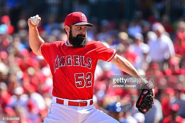 Starting pitcher Matt Shoemaker of the Los Angeles Angels delivers a pitch in the first inning against the Texas Rangers during the spring training...