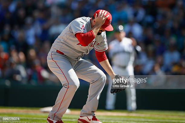 Starting pitcher Matt Shoemaker of the Los Angeles Angels of Anaheim holds his head after being hit with a batted ball off the bat of Kyle Seager of...