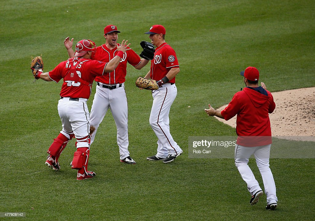 Starting pitcher Max Scherzer #31 of the Washington Nationals (C) celebrates with teammates Wilson Ramos #40, Tyler Moore #12 and Dan Uggla #26 (R) after throwing a 6-0 no hitter to defeat the Pittsburgh Pirates at Nationals Park on June 20, 2015 in Washington, DC.
