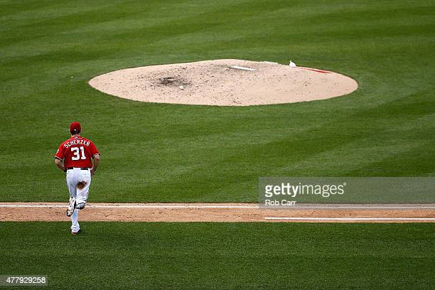 Starting pitcher Max Scherzer of the Washington Nationals talks the mound for the start of the ninth inning against the Pittsburgh Pirates at...
