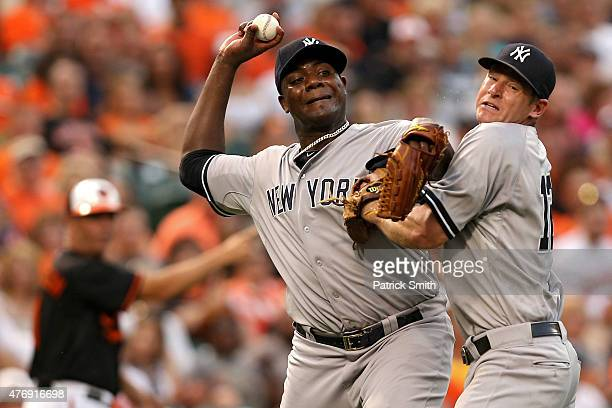 Starting pitcher Michael Pineda of the New York Yankees collides with teammate third baseman Chase Headley as he tries to throw out Jimmy Paredes of...