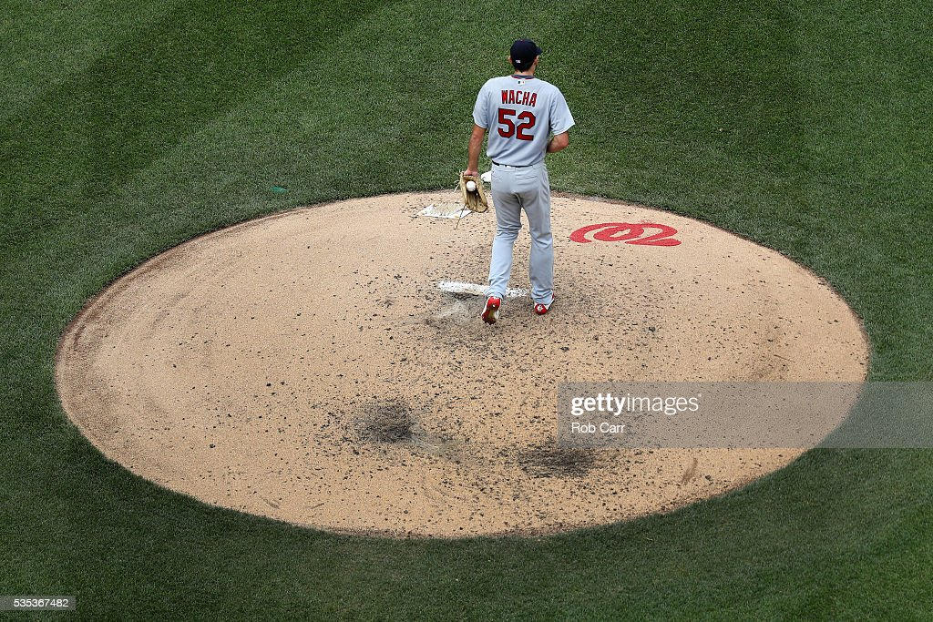 Starting pitcher <a gi-track='captionPersonalityLinkClicked' href=/galleries/search?phrase=Michael+Wacha&family=editorial&specificpeople=10490716 ng-click='$event.stopPropagation()'>Michael Wacha</a> #52 of the St. Louis Cardinals reacts after giving up a fourth inning run to the Washington Nationals at Nationals Park on May 29, 2016 in Washington, DC.