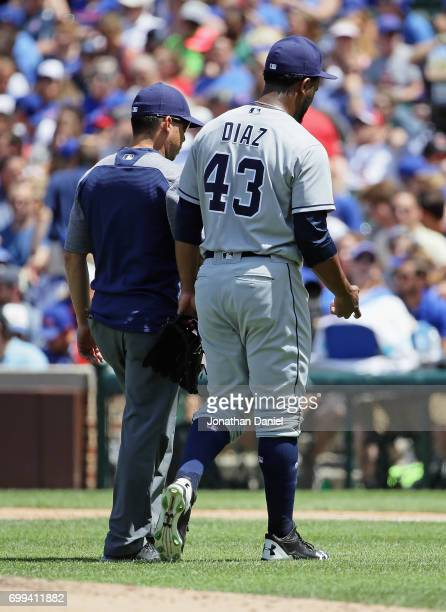 Starting pitcher Miguel Diaz of the San Diego Padres leaves the game in the 3rd inning after suffering an apparent arm injury against the Chicago...