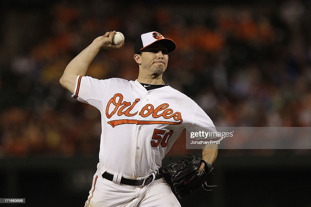 Starting pitcher Miguel Gonzalez #50 of the Baltimore Orioles pitches to a Cleveland Indians batter during the seventh inning at Oriole Park at Camden Yards on June 27, 2013 in Baltimore, Maryland. The Baltimore Orioles won, 7-3.
