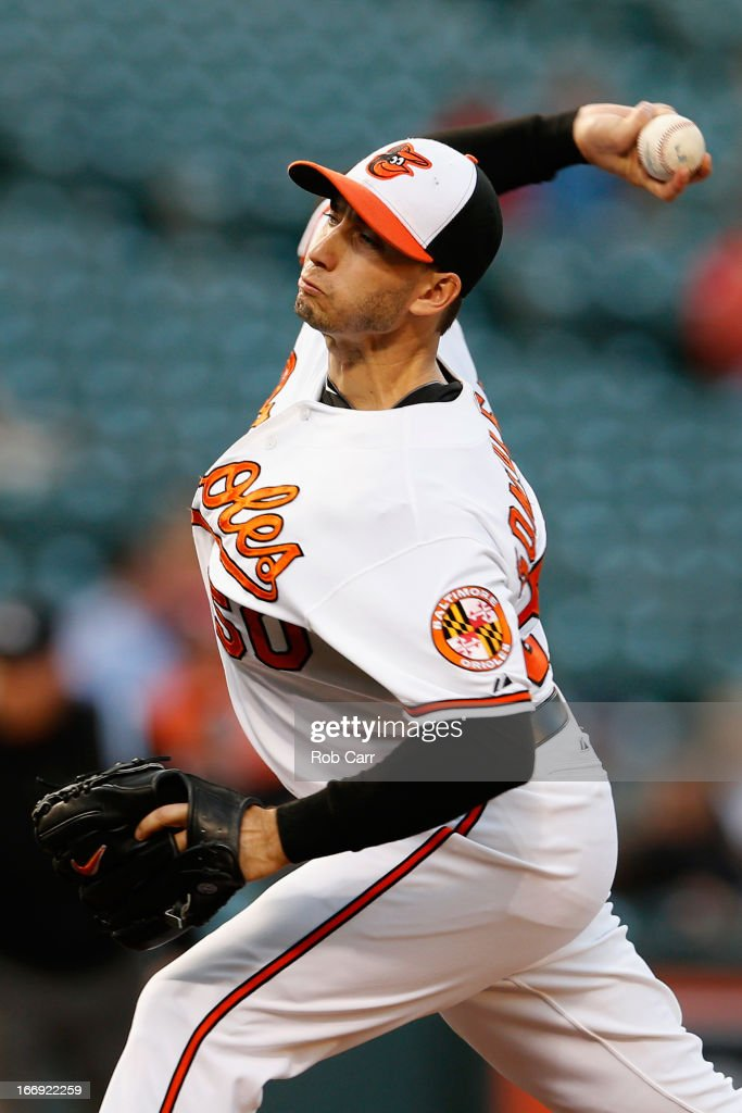 Starting pitcher Miguel Gonzalez #50 of the Baltimore Orioles throws to a Tampa Bay Rays batter during the first inning at Oriole Park at Camden Yards on April 18, 2013 in Baltimore, Maryland.