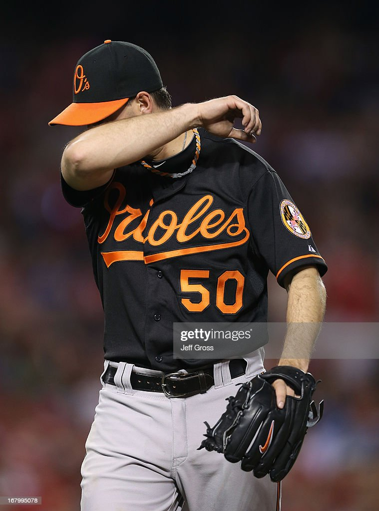 Starting pitcher Miguel Gonzalez #50 of the Baltimore Orioles wipes his brau as he walks back to the dugout after giving up a two-run home run to Mike Trout (not pictured) of the Los Angeles Angels of Anaheim in the fifth inning at Angel Stadium of Anaheim on May 3, 2013 in Anaheim, California. The Angels defeated the Orioles 4-0.