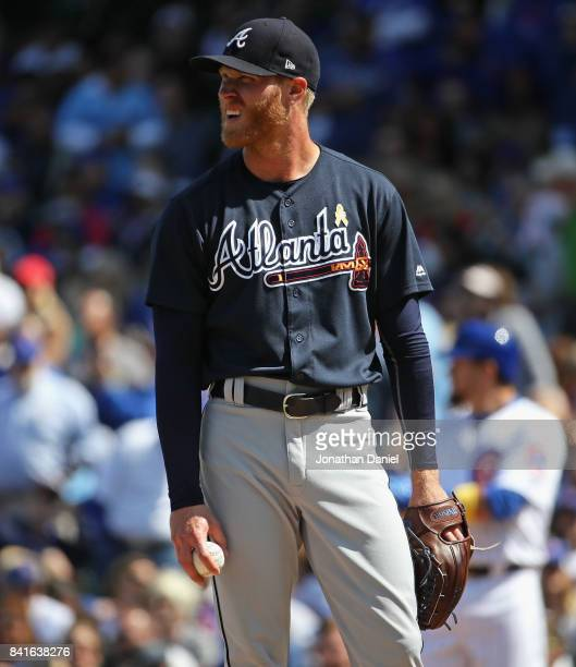 Starting pitcher Mike Foltynewicz of the Atlanta Braves reacts after watching a replay when he gave up a run in the 3rd inning against the Chicago...