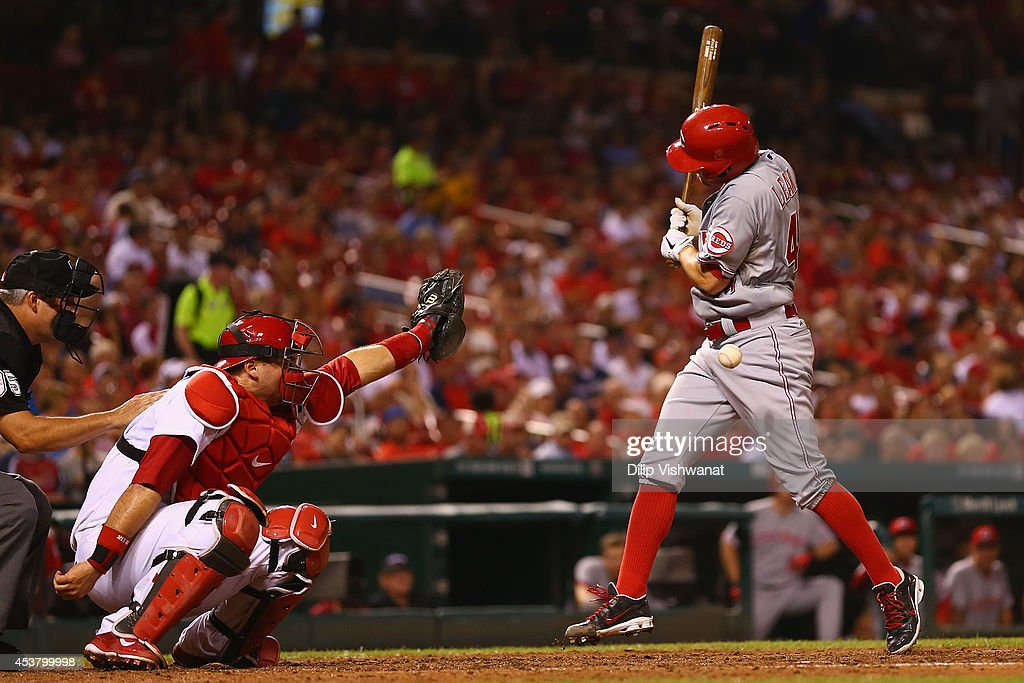 Starting pitcher <a gi-track='captionPersonalityLinkClicked' href=/galleries/search?phrase=Mike+Leake&family=editorial&specificpeople=5330779 ng-click='$event.stopPropagation()'>Mike Leake</a> #44 of the Cincinnati Reds is hit by a pitch in the fifth inning against the St. Louis Cardinals at Busch Stadium on August 18, 2014 in St. Louis, Missouri. The Cardinals beat the Reds in 10 innings.