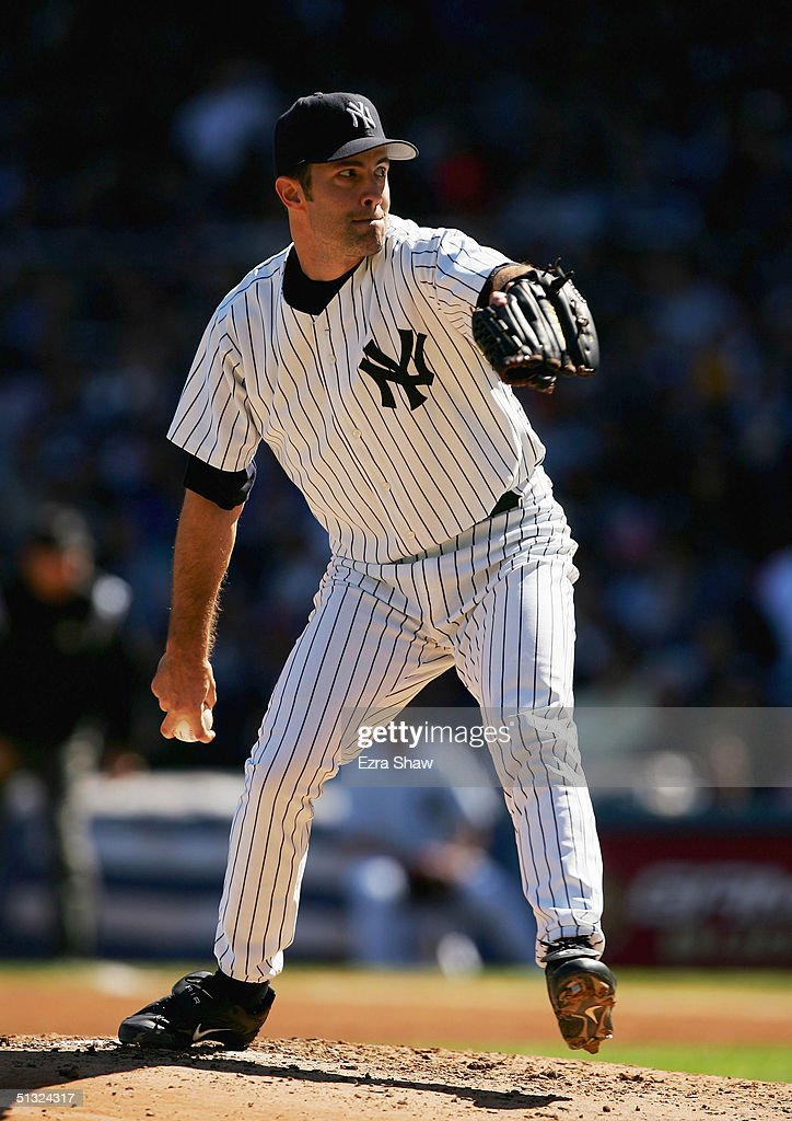 Starting pitcher Mike Mussina #35 of the New York Yankees pitches against the Boston Red Sox on September 19, 2004 at Yankee Stadium in the Bronx, New York. The Yankees beat the Red Sox 11-1.