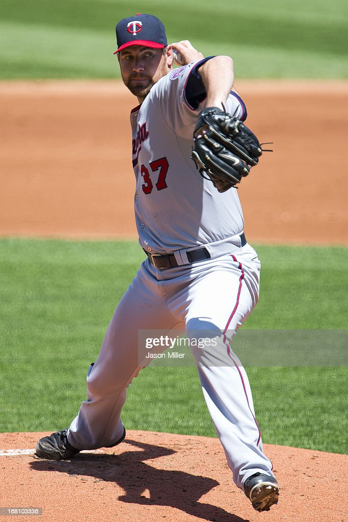 Starting pitcher <a gi-track='captionPersonalityLinkClicked' href=/galleries/search?phrase=Mike+Pelfrey&family=editorial&specificpeople=836534 ng-click='$event.stopPropagation()'>Mike Pelfrey</a> #37 of the Minnesota Twins pitches during the first inning against the Cleveland Indians at Progressive Field on May 5, 2013 in Cleveland, Ohio.