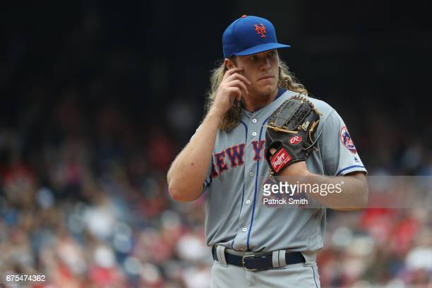 Starting pitcher Noah Syndergaard of the New York Mets looks on during the first inning against the Washington Nationals at Nationals Park on April...