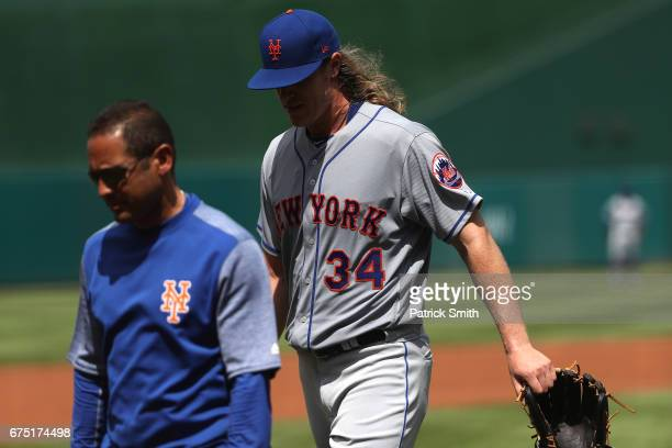 Starting pitcher Noah Syndergaard of the New York Mets walks off of the field after an injury during the second inning against the Washington...