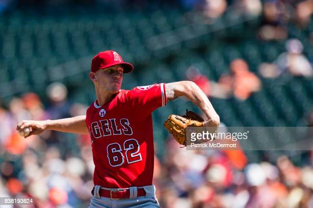 Starting pitcher Parker Bridwell of the Los Angeles Angels of Anaheim throws a pitch to a Baltimore Orioles batter in the second inning during a game...