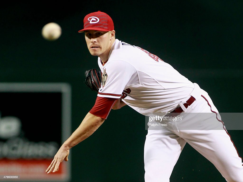 Starting pitcher Patrick Corbin of the Arizona Diamondbacks delivers a pitch against the Colorado Rockies during the first inning of a MLB game at...