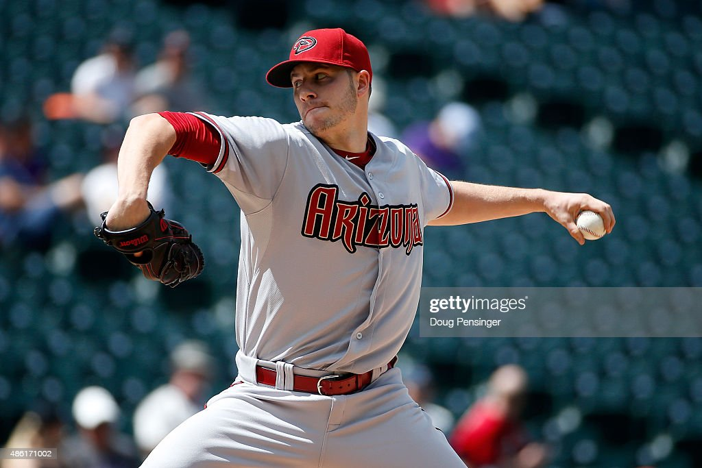 Starting pitcher Patrick Corbin of the Arizona Diamondbacks delivers against the Colorado Rockies at Coors Field on September 1 2015 in Denver...
