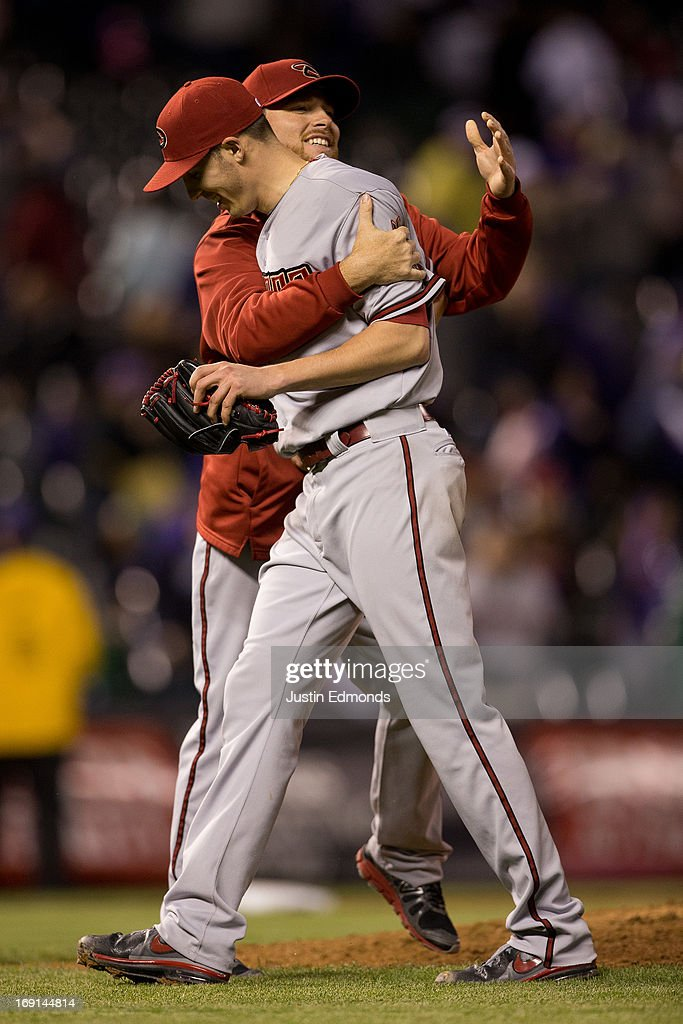 Starting pitcher Patrick Corbin #46 of the Arizona Diamondbacks is congratulated by teammate Ian Kennedy #31 after Corbin threw a three hit complete game against the Colorado Rockies at Coors Field on May 20, 2013 in Denver, Colorado. The Diamondbacks defeated the Rockies 5-1.
