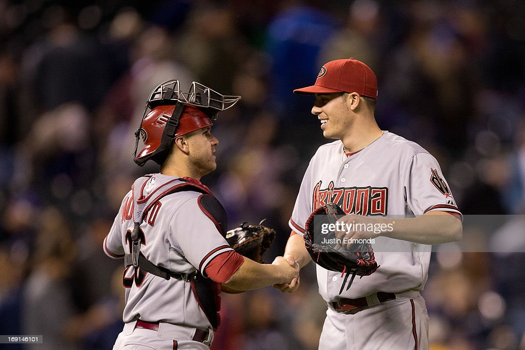 Starting pitcher Patrick Corbin #46 of the Arizona Diamondbacks is congratulated by catcher <a gi-track='captionPersonalityLinkClicked' href=/galleries/search?phrase=Miguel+Montero&family=editorial&specificpeople=836495 ng-click='$event.stopPropagation()'>Miguel Montero</a> #26 after the game against the Colorado Rockies at Coors Field on May 20, 2013 in Denver, Colorado. The Diamondbacks defeated the Rockies 5-1.