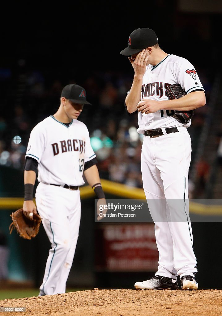 Starting pitcher <a gi-track='captionPersonalityLinkClicked' href=/galleries/search?phrase=Patrick+Corbin+-+Baseball+Player&family=editorial&specificpeople=10882576 ng-click='$event.stopPropagation()'>Patrick Corbin</a> #46 of the Arizona Diamondbacks reacts before being removed during the fourth inning of the MLB game against the Arizona Diamondbacks at Chase Field on May 31, 2016 in Phoenix, Arizona.