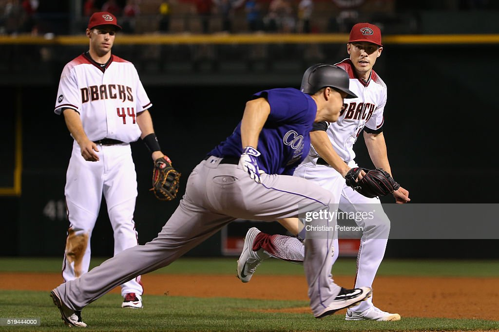 Starting pitcher Patrick Corbin #46 of the Arizona Diamondbacks tags out Nick Hundley #4 of the Colorado Rockies during the fifth inning of the MLB game at Chase Field on April 6, 2016 in Phoenix, Arizona.