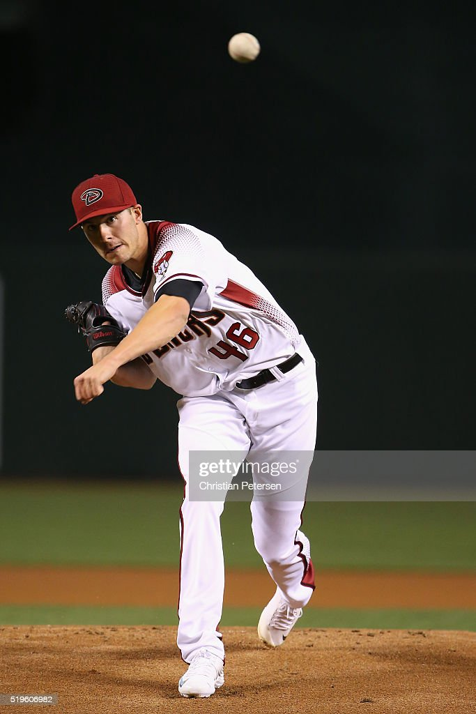 Starting pitcher Patrick Corbin of the Arizona Diamondbacks throws a warm up pitch during the MLB game against the Colorado Rockies at Chase Field on...