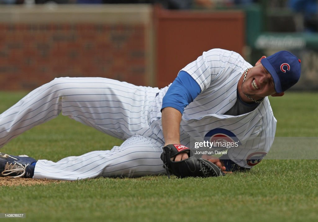 Starting pitcher <a gi-track='captionPersonalityLinkClicked' href=/galleries/search?phrase=Paul+Maholm&family=editorial&specificpeople=585406 ng-click='$event.stopPropagation()'>Paul Maholm</a> #28 of the Chicago Cubs reacts after being hit in the leg on a ball by Dee Gordon of the Los Angeles Dodgers at Wrigley Field on May 4, 2012 in Chicago, Illinois.