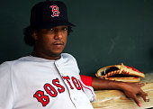 Starting pitcher Pedro Martinez of the Boston Red Sox sits in the dugout prior to the game against the Baltimore Orioles July 26 2004 at Camden Yards...