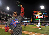 Starting pitcher Pedro Martinez of the Philadelphia Phillies waves to the fans after beating the Houston Astros 103 and winning the National League...
