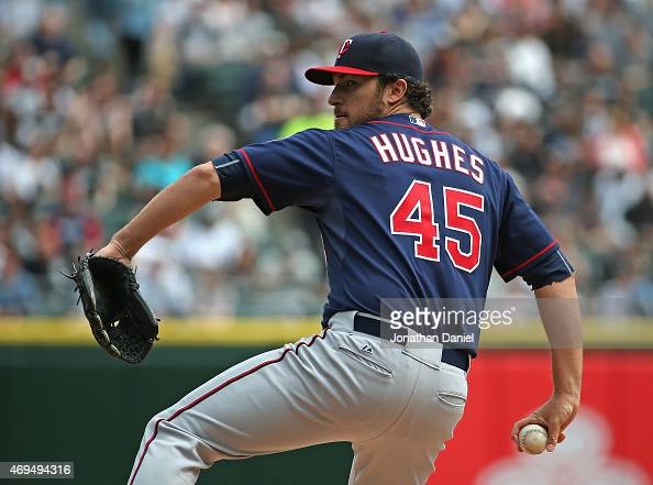 Starting pitcher Phil Hughes of the Minnesota Twins delivers the ball against the Chicago White Sox at US Cellular Field on April 12 2015 in Chicago...