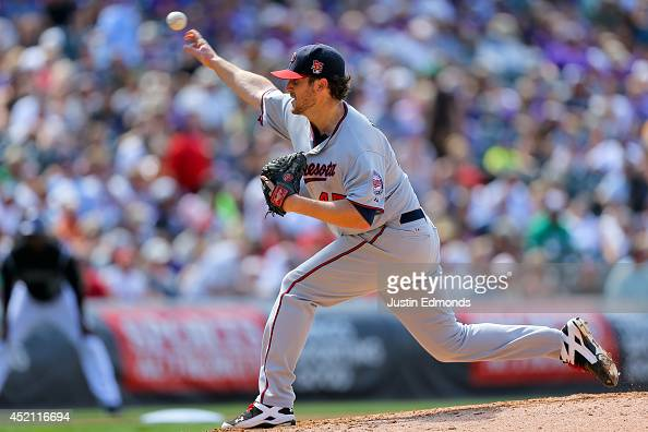 Starting pitcher Phil Hughes of the Minnesota Twins delivers to home plate during the fourth inning against the Colorado Rockies at Coors Field on...