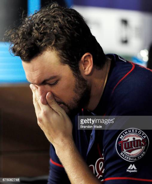 Starting pitcher Phil Hughes of the Minnesota Twins is seen in the dugout during the fifth inning of a baseball game against the Texas Rangers at...
