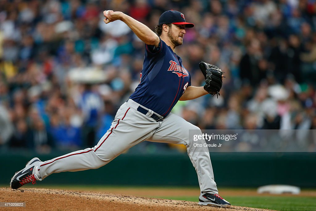 Starting pitcher Phil Hughes of the Minnesota Twins pitches against the Seattle Mariners in the third inning at Safeco Field on April 24 2015 in...