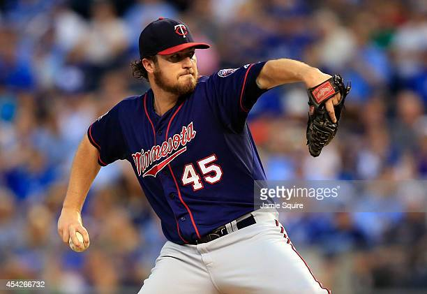 Starting pitcher Phil Hughes of the Minnesota Twins pitches during the game against the Kansas City Royals at Kauffman Stadium on August 27 2014 in...