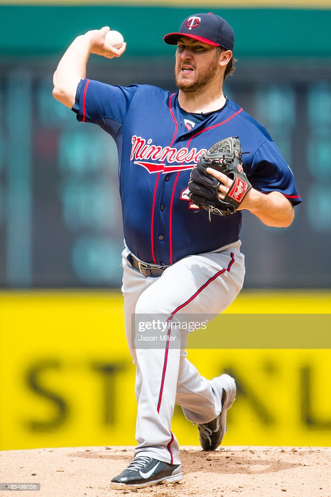 Starting pitcher Phil Hughes of the Minnesota Twins pitches during the first inning against the Cleveland Indians at Progressive Field on August 9...