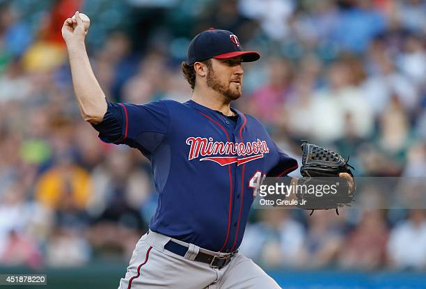 Starting pitcher Phil Hughes of the Minnesota Twins pitches in the first inning against the Seattle Mariners at Safeco Field on July 8 2014 in...