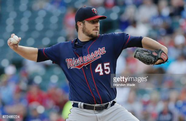 Starting pitcher Phil Hughes of the Minnesota Twins throws during the first inning of a baseball game against the Texas Rangers at Globe Life Park on...