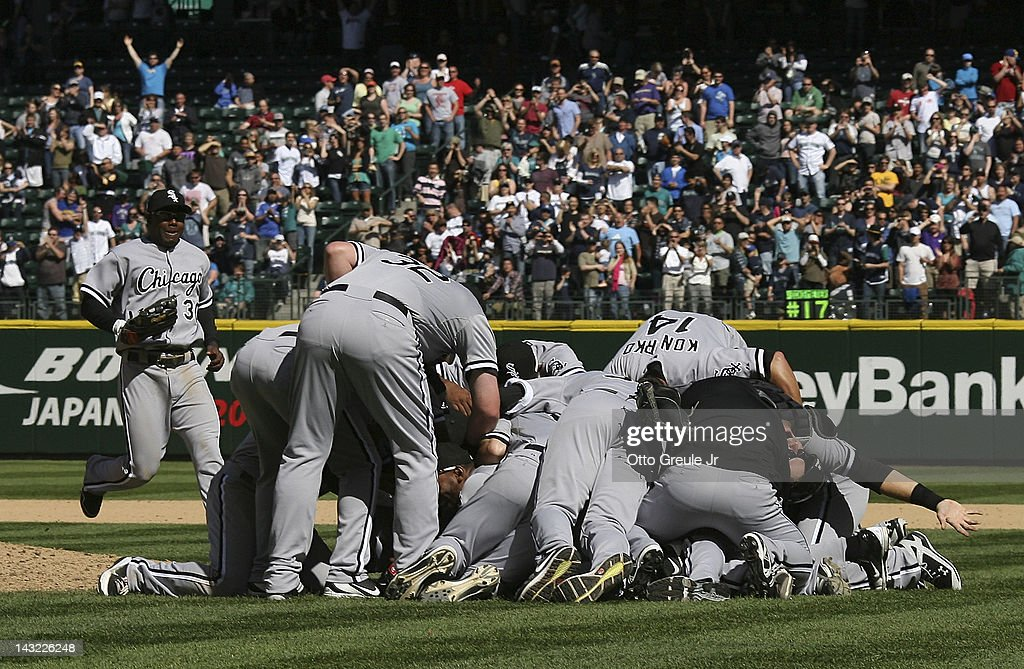 Starting pitcher <a gi-track='captionPersonalityLinkClicked' href=/galleries/search?phrase=Philip+Humber&family=editorial&specificpeople=836505 ng-click='$event.stopPropagation()'>Philip Humber</a> #41 of the Chicago White Sox is mobbed by teammates after throwing a perfect game against the Seattle Mariners at Safeco Field on April 21, 2012 in Seattle, Washington. This was the 21st perfect game in Major League Baseball history.