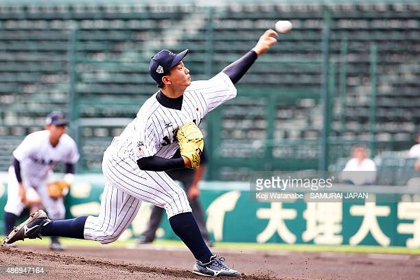 Starting pitcher pitcher Shinnosuke Ogasawara pitches in the top half of the first inning in the super round game between Japan v Cuba during the...
