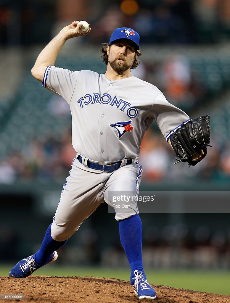 Starting pitcher R.A. Dickey #43 of the Toronto Blue Jays throws to a Baltimore Orioles batter at Oriole Park at Camden Yards on April 23, 2013 in Baltimore, Maryland.