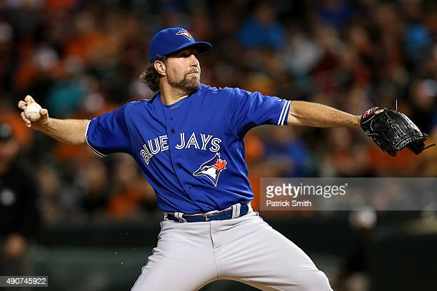 Starting pitcher RA Dickey of the Toronto Blue Jays works the third inning against the Baltimore Orioles during game two of a double header at Oriole...