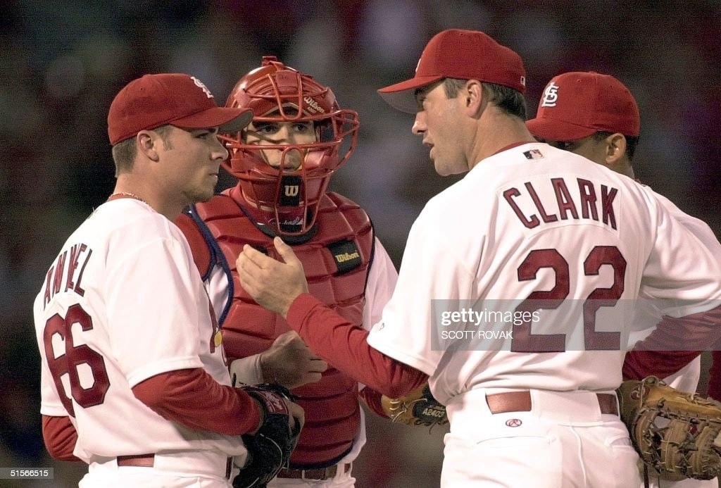 Starting pitcher Rick Ankiel of the St Louis Cardinals talks with catcher Eli Marrero and first baseman Will Clark in the first inning during game...