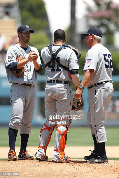Starting pitcher Rick Porcello of the Detroit Tigers has a conference at the pitcher's mound with catcher Victor Martinez and pitching coach Rick...