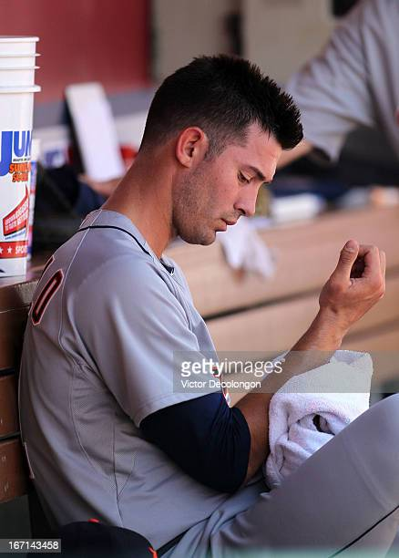 Starting pitcher Rick Porcello of the Detroit Tigers sits in the dugout after being pulled from the game in the first inning after giving up nine...