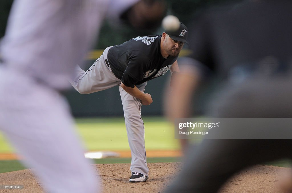 Starting pitcher <a gi-track='captionPersonalityLinkClicked' href=/galleries/search?phrase=Ricky+Nolasco&family=editorial&specificpeople=600111 ng-click='$event.stopPropagation()'>Ricky Nolasco</a> #47 of the Florida Marlins delivers against the Colorado Rockies at Coors Field on August 17, 2011 in Denver, Colorado. Nolasco collected the loss as the Rockies defeated the Marlins 12-5.