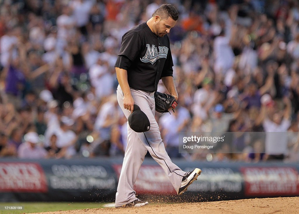 Starting pitcher <a gi-track='captionPersonalityLinkClicked' href=/galleries/search?phrase=Ricky+Nolasco&family=editorial&specificpeople=600111 ng-click='$event.stopPropagation()'>Ricky Nolasco</a> #47 of the Florida Marlins kicks the dirt s he returns to the mound after giving up a three run homerun to Carlos Gonzalez #5 of the Colorado Rockies to give the Rockies a 11-0 lead in the third inning at Coors Field on August 17, 2011 in Denver, Colorado.