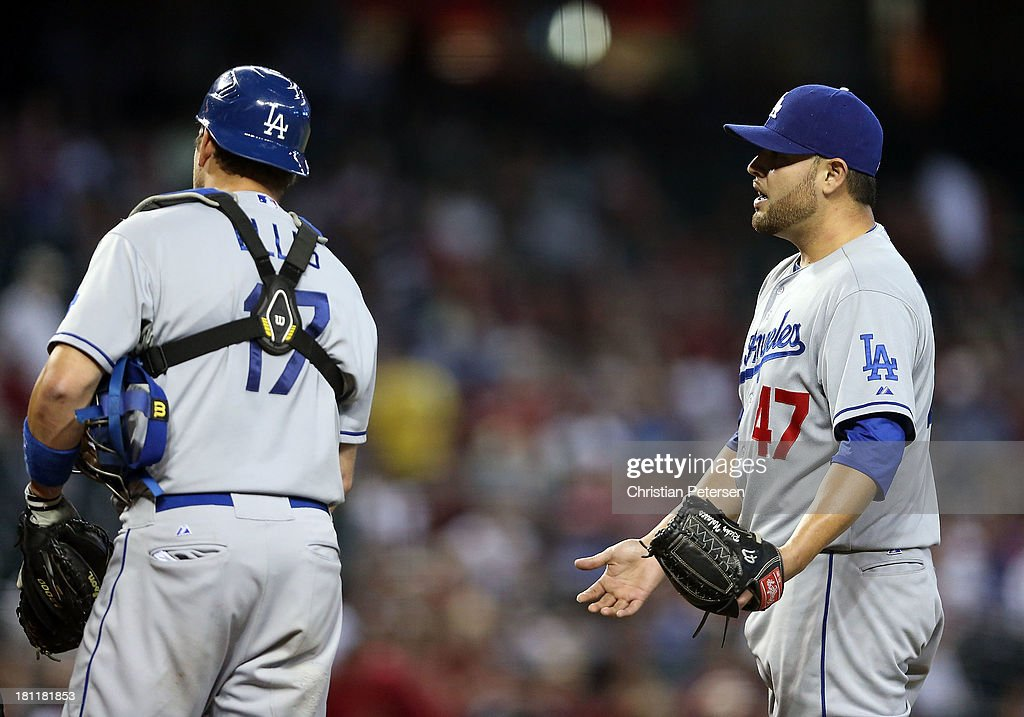 Starting pitcher <a gi-track='captionPersonalityLinkClicked' href=/galleries/search?phrase=Ricky+Nolasco&family=editorial&specificpeople=600111 ng-click='$event.stopPropagation()'>Ricky Nolasco</a> #47 of the Los Angeles Dodgers reacts after he was given a warning for hitting an Arizona Diamondbacks batter during the fourth inning of the MLB game at Chase Field on September 19, 2013 in Phoenix, Arizona.