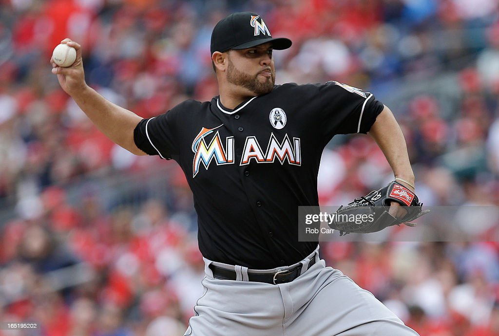 Starting pitcher <a gi-track='captionPersonalityLinkClicked' href=/galleries/search?phrase=Ricky+Nolasco&family=editorial&specificpeople=600111 ng-click='$event.stopPropagation()'>Ricky Nolasco</a> #47 of the Miami Marlins throws to a Washington Nationals batter during the third inning of their opening day game at Nationals Park on April 1, 2013 in Washington, DC.