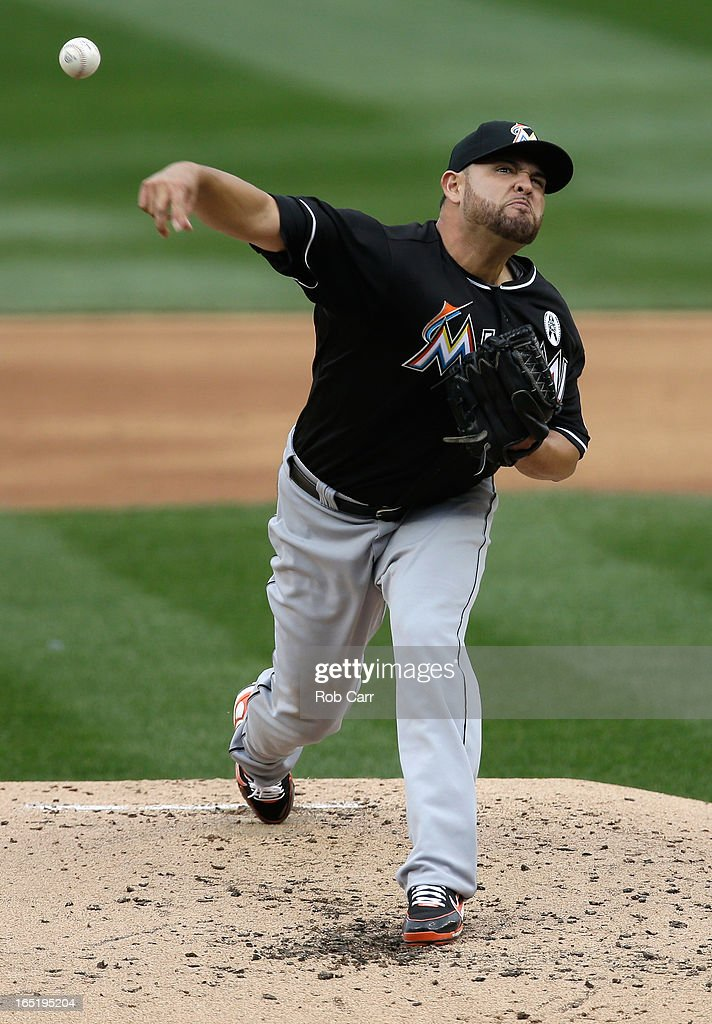 Starting pitcher <a gi-track='captionPersonalityLinkClicked' href=/galleries/search?phrase=Ricky+Nolasco&family=editorial&specificpeople=600111 ng-click='$event.stopPropagation()'>Ricky Nolasco</a> #47 of the Miami Marlins throws to a Washington Nationals batter during the second inning of their opening day game at Nationals Park on April 1, 2013 in Washington, DC.
