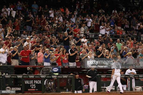 Starting pitcher Robbie Ray of the Arizona Diamondbacks is cheered by fans after being removed in the seventh inning of the MLB game against the San...