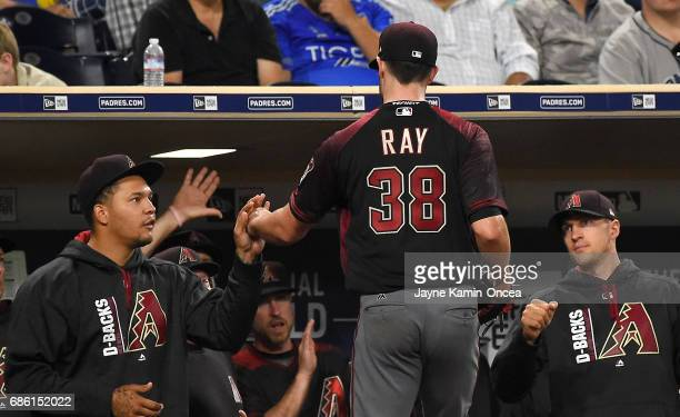 Starting pitcher Robbie Ray of the Arizona Diamondbacks is greeted in the dugout after leaving the game against the San Diego Padres in the eighth...